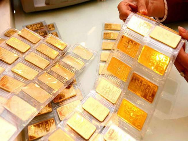 Vàng quay đầu giảm phiên cuối tuần vì áp lực USD mạnh lên - ảnh 1