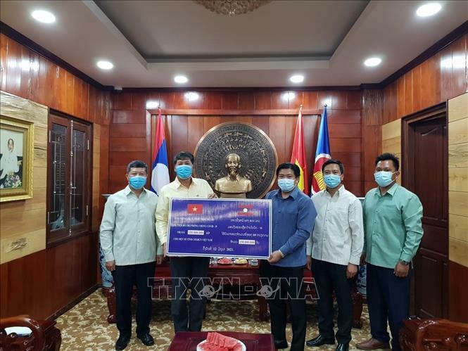 Các tỉnh của Lào hỗ trợ địa phương Việt Nam phòng, chống dịch COVID-19 - ảnh 1