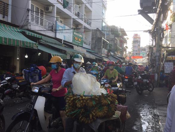TP.HCM khẩn tìm người đã đến chợ đầu mối Hóc Môn, Bình Điền và chợ Sơn Kỳ - ảnh 1