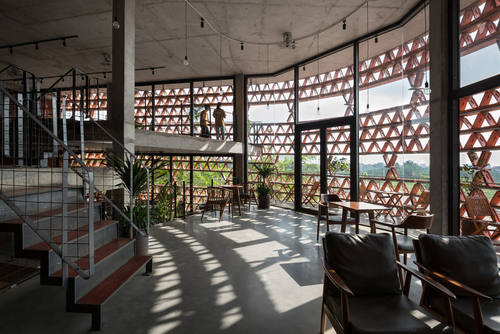 Quán cà phê lấy cảm hứng từ cành cây và hang động của người tiền sử ở Hà Nội đẹp lạ trên báo Mỹ - ảnh 13