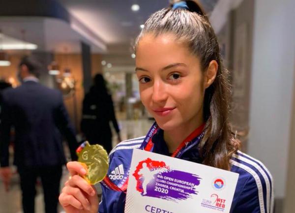 [ẢNH] Nữ võ sỹ tuổi teen gây sốt ở thảm đấu Olympic Tokyo - ảnh 3