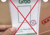 Tràn lan ''thẻ đi đường'' có logo và con dấu của Grab
