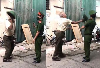 Hà Nội: Không đeo khẩu trang bị nhắc nhở, cụ ông vụt mũ cối thẳng mặt công an