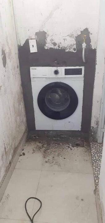 Ở nhà mùa dịch, nam thanh niên có phát minh đi vào lòng đất: Khi máy giặt được thiết kế âm tường!