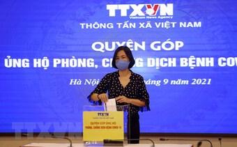 Cán bộ, nhân viên TTXVN quyên góp ủng hộ công tác chống dịch